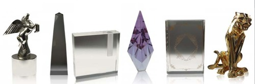 6 luxury gifts from our online boutique. From left to right, Pegasus Award, Modern Obelisk in Lucite, Crystal Bud Holder, Purple Gabrielle Crystal, SA Crystal Book, Imposing Cat
