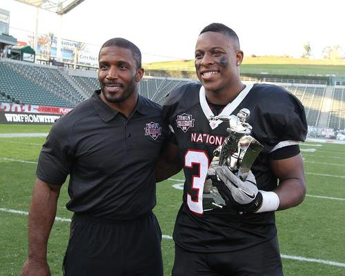 Terrell Watson in NFLPA Nationals uniform with his Collegiate Bowl MVP Trophy
