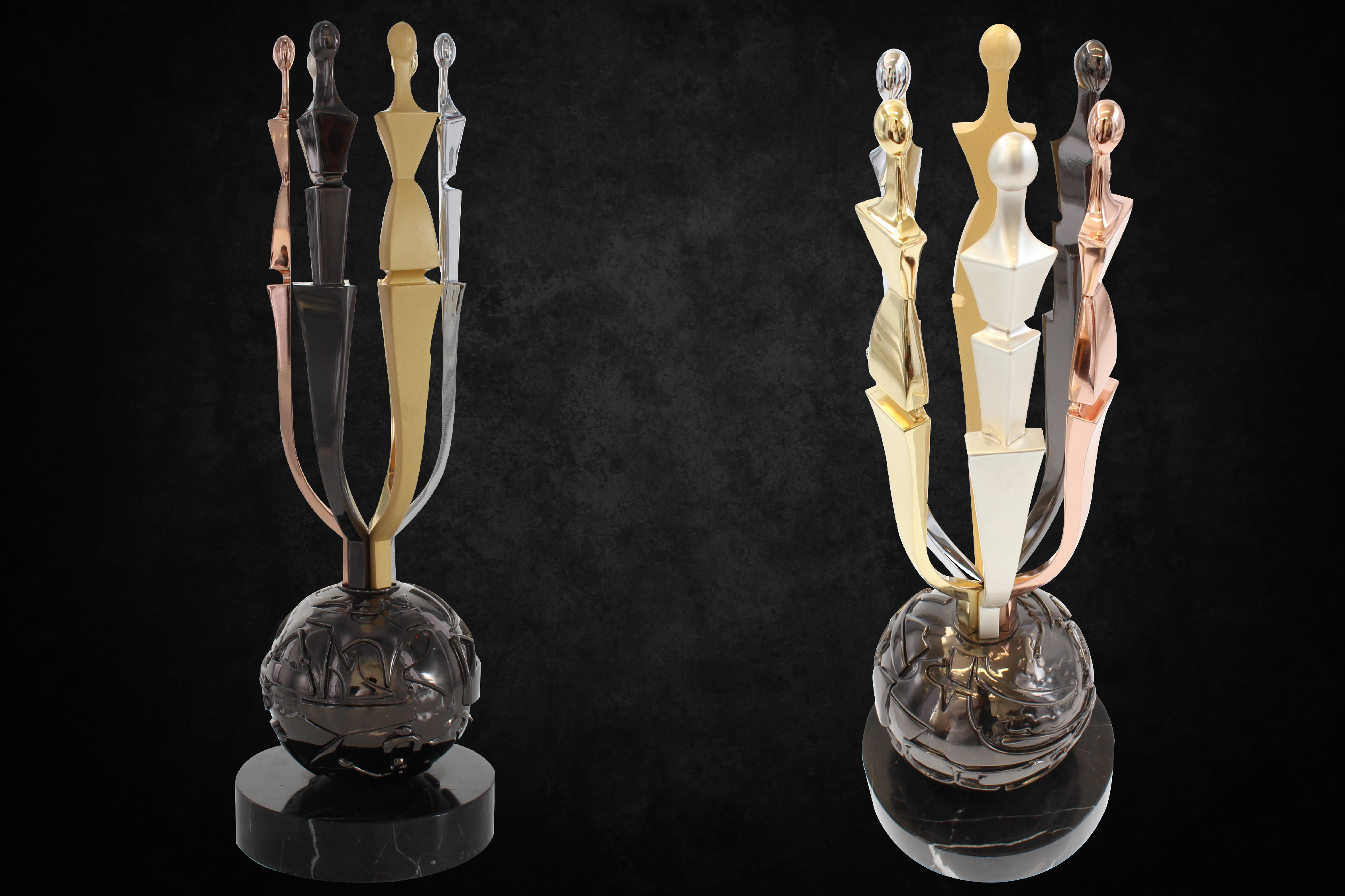 AAFA American Image Awards trophy, a marble base with a black chrome globe, 6 abstact figures emerging from the top