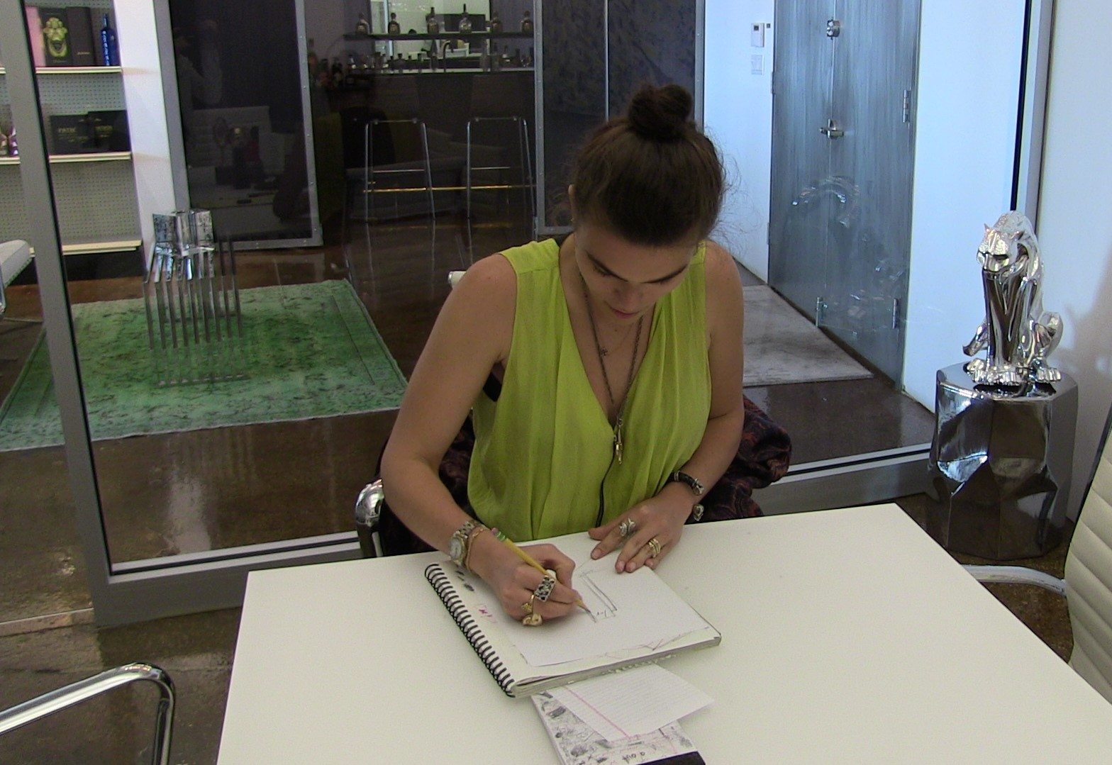 Vicky Fotopoulou, 3D Designer, sitting and sketching an award design in our New York office