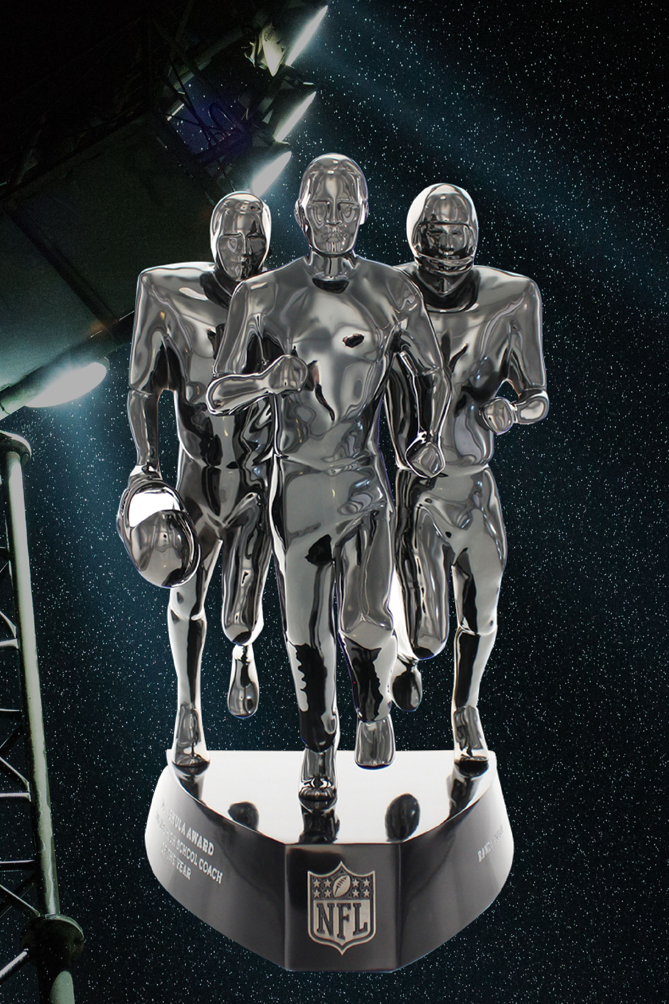 Front view, NFL Don Shula trophy superimposed over football stadium lights. Award has 3 metal figures in running pose