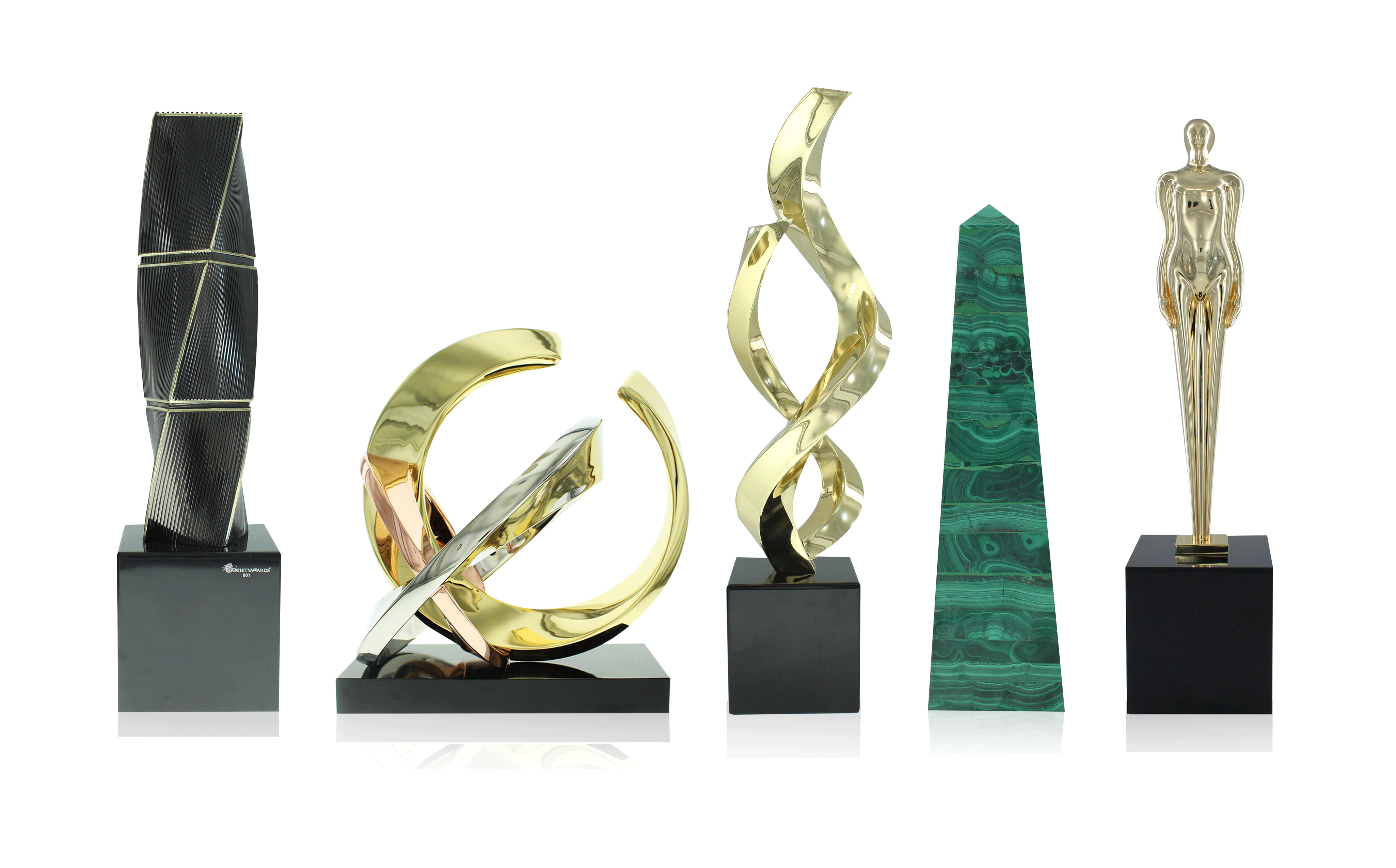 5 trophies from the World's First Limited Editions Collection of awards. From left to right: Twist Texture, Rings, Ribbons, Malachite Obelisk, Figure.