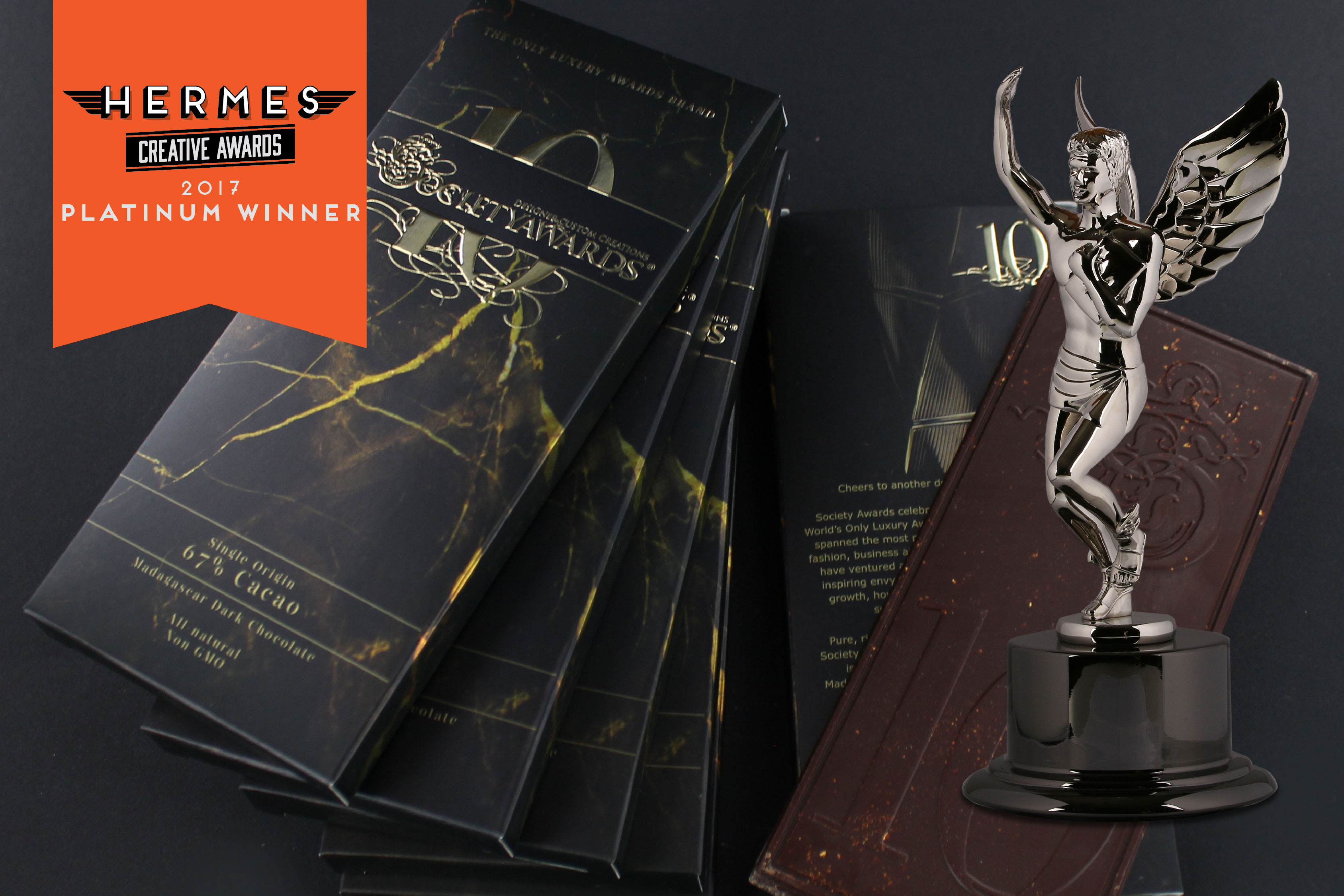 Stack of custom chocolate bar boxes designed by Viceroy Creative for our 10 Year Anniversary Chocolate. Also, image of Hermes award