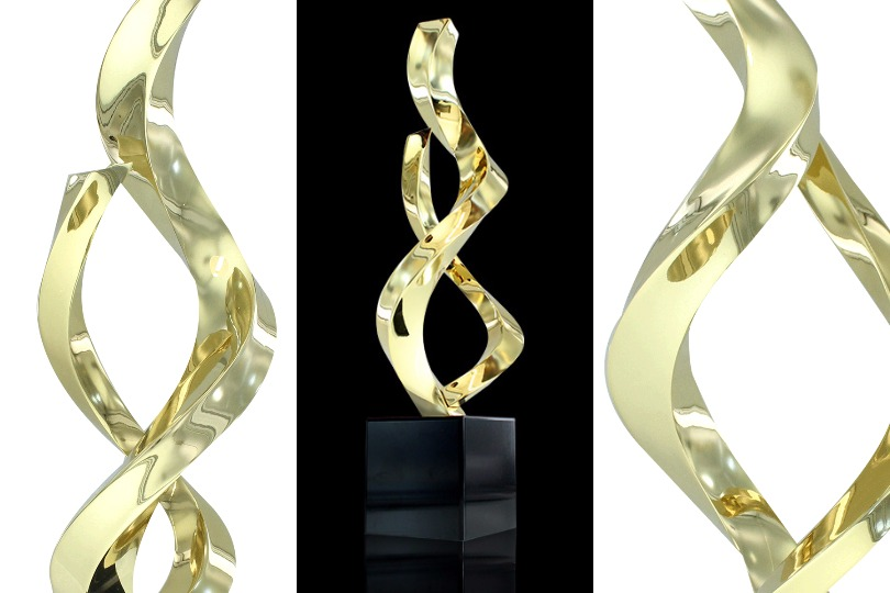 3 views of limited edition Ribbons 1 award. Design has two twisting gold-plated bands rising out of a black metal base