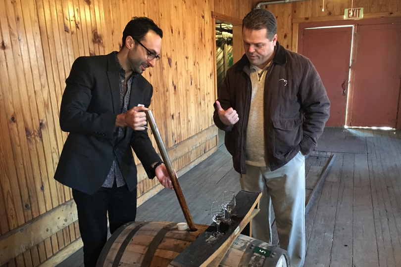 CEO David Moritz using a copper whiskey thief to pull Eagle Rare bourbon from a barrel at the Buffalo Trace Distillery