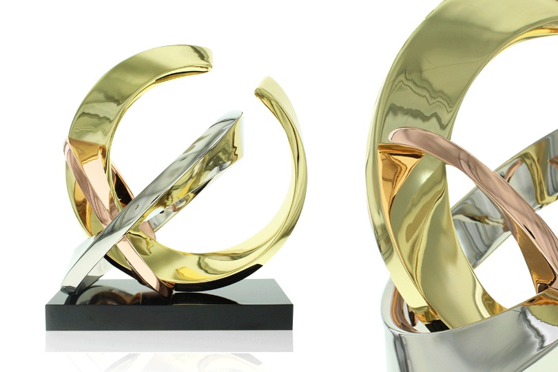 2 views of limited edition Rings 1 award made up of 3 rings of varied size in 24k gold, polished chrome, rose gold