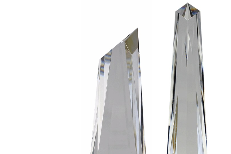 Side and front views of the prismatic top of the Metropolis Crystal award