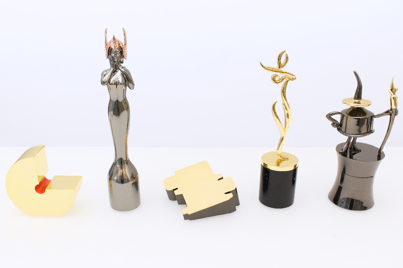 5 famous custom trophies by Society Awards on a conference table