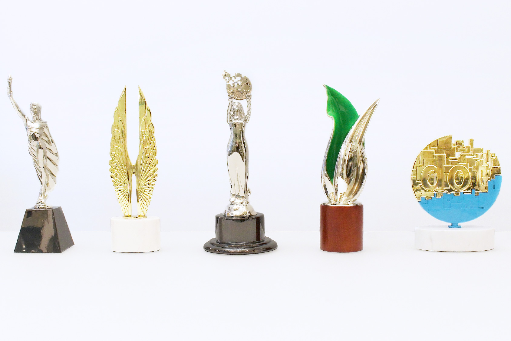 Five Custom Metal Trophies created by Society Awards for AMCP