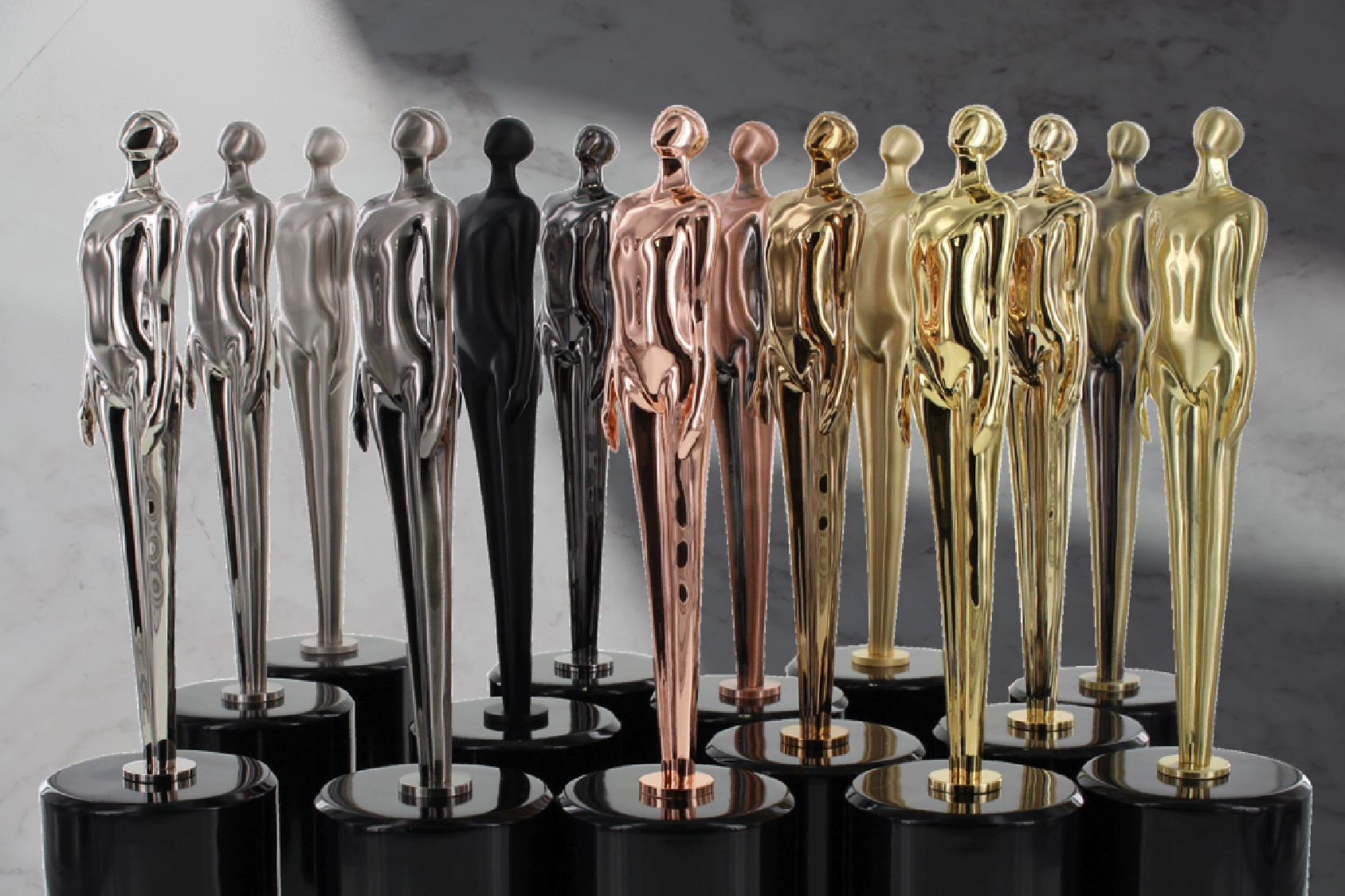 A collection of the Proud Form trophy in all different custom electroplated finishes
