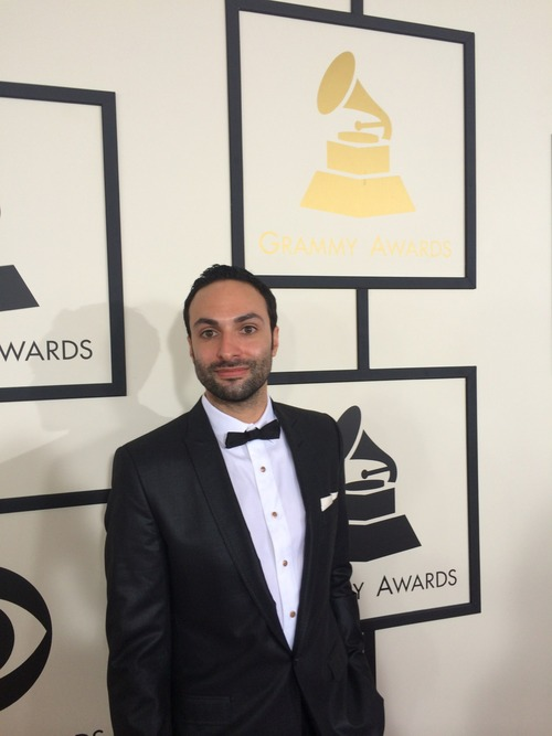 David Moritz, Founder and CEO standing on the red carpet at the Grammy Awards in a black tuxedo
