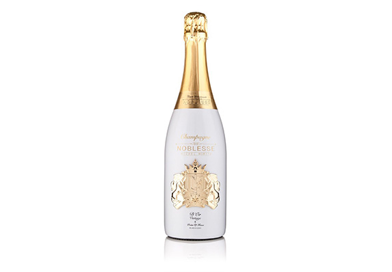 sculptural cast perfectly fitted to champagne bottle gold plated medallion for Noblesse Champagne