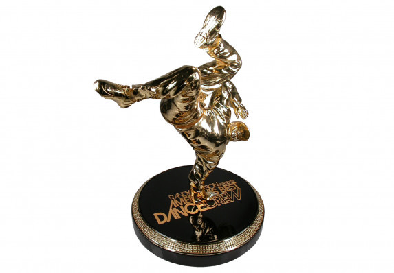 Impressive custom award with a cast resin break dancer. The dancer's legs move on a heavy duty spring. The base is designed to look like a turntable. Designed and made by Society Awards for MTV's America's Best Dance Crew (ABDC)