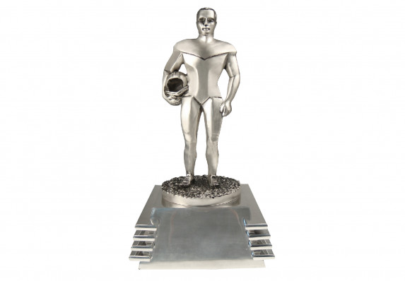 Metal figure on base in brushed silver finish.