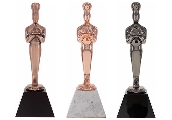 Custom Awards crafted in metal with a variety of luxury electroplated finishes and mounted on crystal and marble bases.