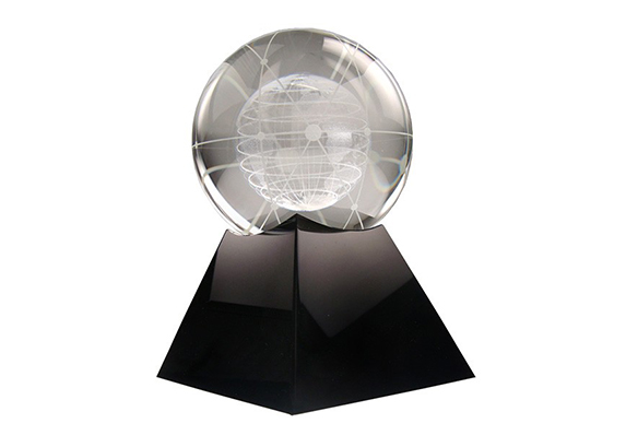 crystal globe with beautiful complex 3D etching on black crystal base