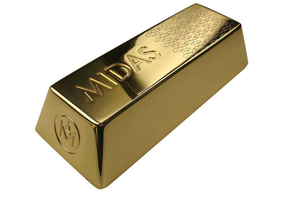 Gold bar award created in cast metal and plated in 24k gold. Finished with detailed hand-polishing.