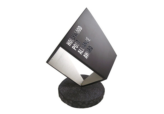 Abstract sculpture trophy on faux granite base. Logo is printed with gloss finish to contrast matte black surface.