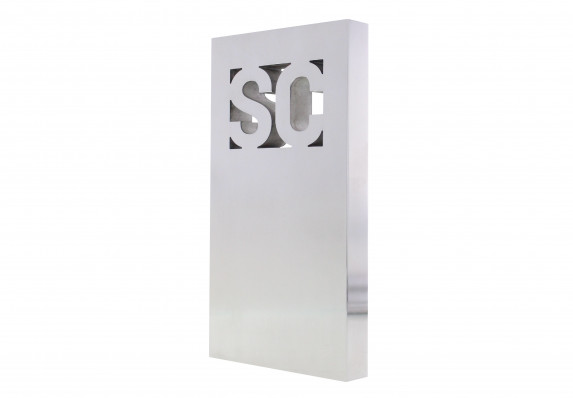 "Free-standing aluminum plaque machined with relief of the letters ""S"" and ""C."" Highly polished surface."