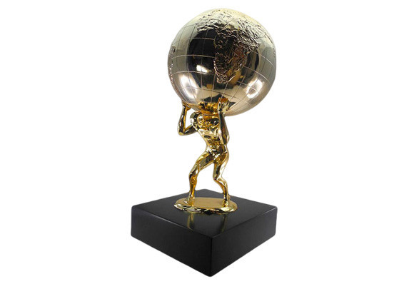 Metal figure holding up a globe, both plated in gold. Mounted on black base.
