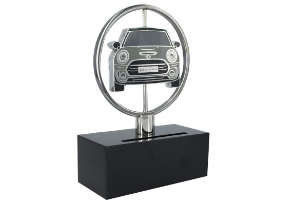 Spinning custom award designed in the image of a new model vehicle. The vehicle 'medallion,' finished with high-end enamel, is two-sided and can be turned to reveal a likeness of the rear end of the car on the reverse.