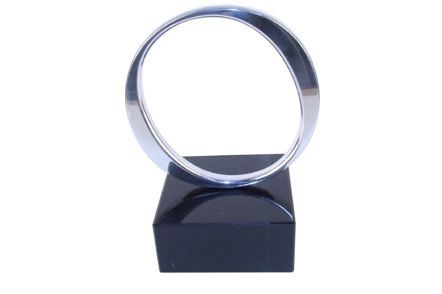 Circle ring polished aluminum on marble base
