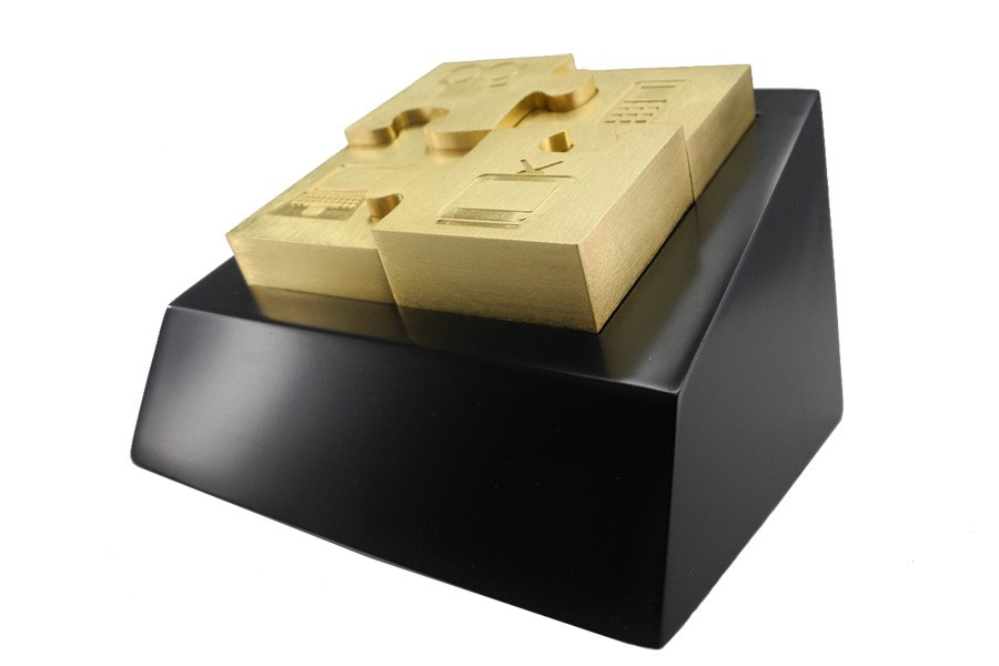 Removeable puzzle trophy in brushed satin finish each printed with media icons. Final award arrives in custom presentation box