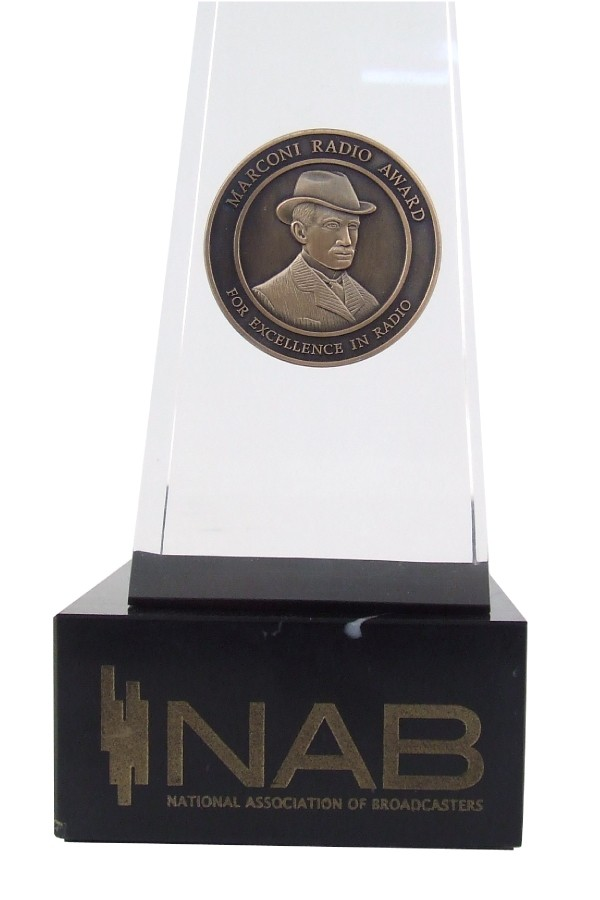 Closeup of NAB medal embedded in Lucite acrylic