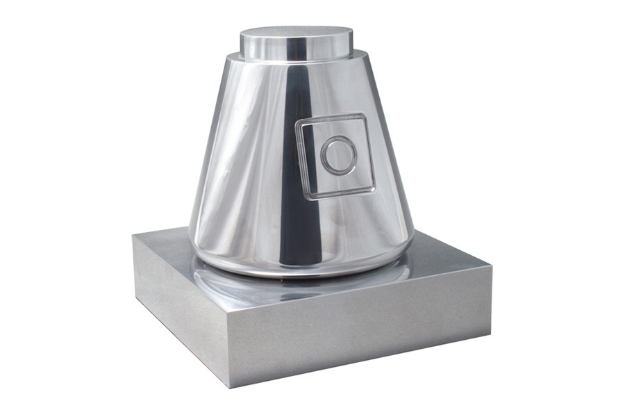 Machined aluminum trophy with a design based on the Space X Dragon capsule presented by The Explorers Club to Elon Musk