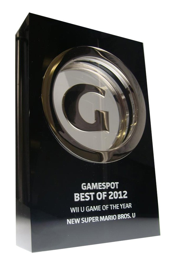 Trophy with suspended silver letter G in black crystal block. Shown with etched personalization.