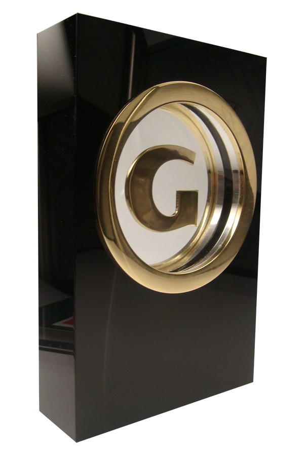 Gamespot trophy with golden letter G suspended inside center of a black crystal block.