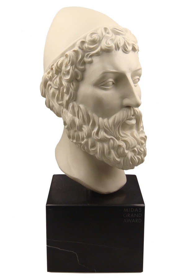 Bust sculpture of King Midas mounted on a black base.
