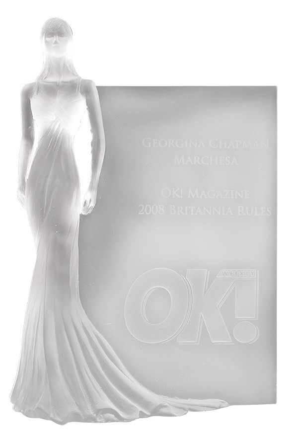 Lost wax cast custom crystal award. A 3-Dimensional woman in an elegant gown standing in front of a plaque.