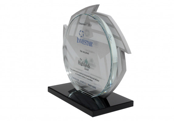 Deal gift commemorating the close of an acquisition finance deal. The form has a machined acrylic logo with etching with a second tombstone plaque on top both mounted on base.