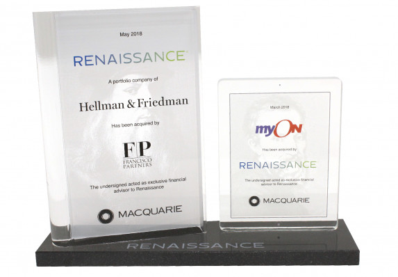 Deal gift with two glass plaques mounted side by side on a marble base with etched logo. Created to recognize a series of acquisitions.
