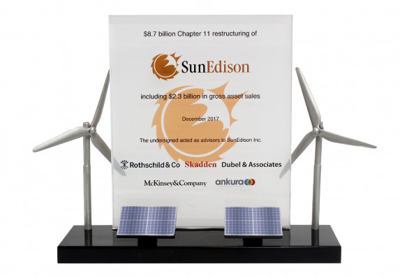 A custom deal gift with models of wind turbines and solar panels mounted on base with a full-color financial tombstone plaque.