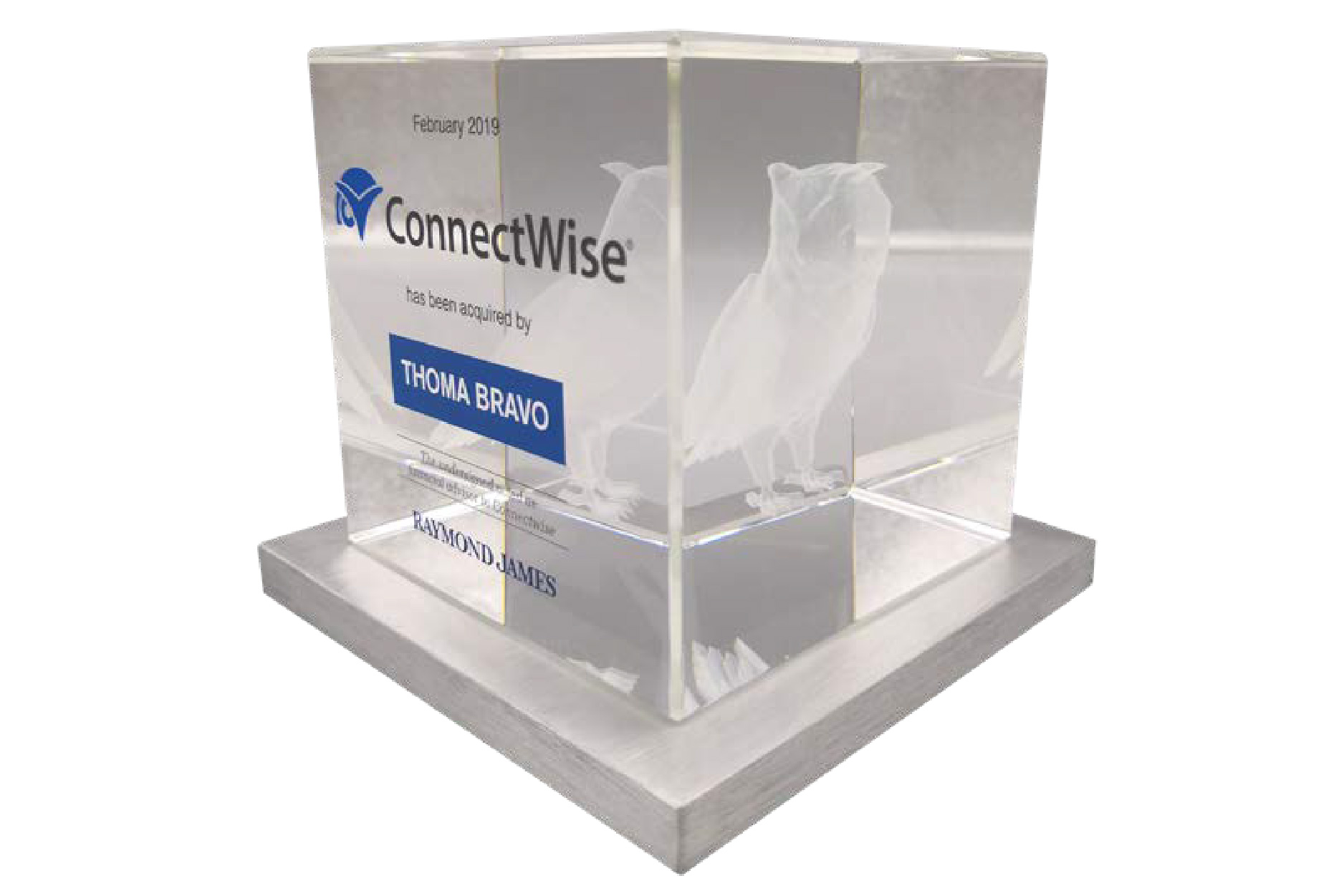 Crystal cube deal toy with a 3D etched owl, logos and detailed tombstone text.