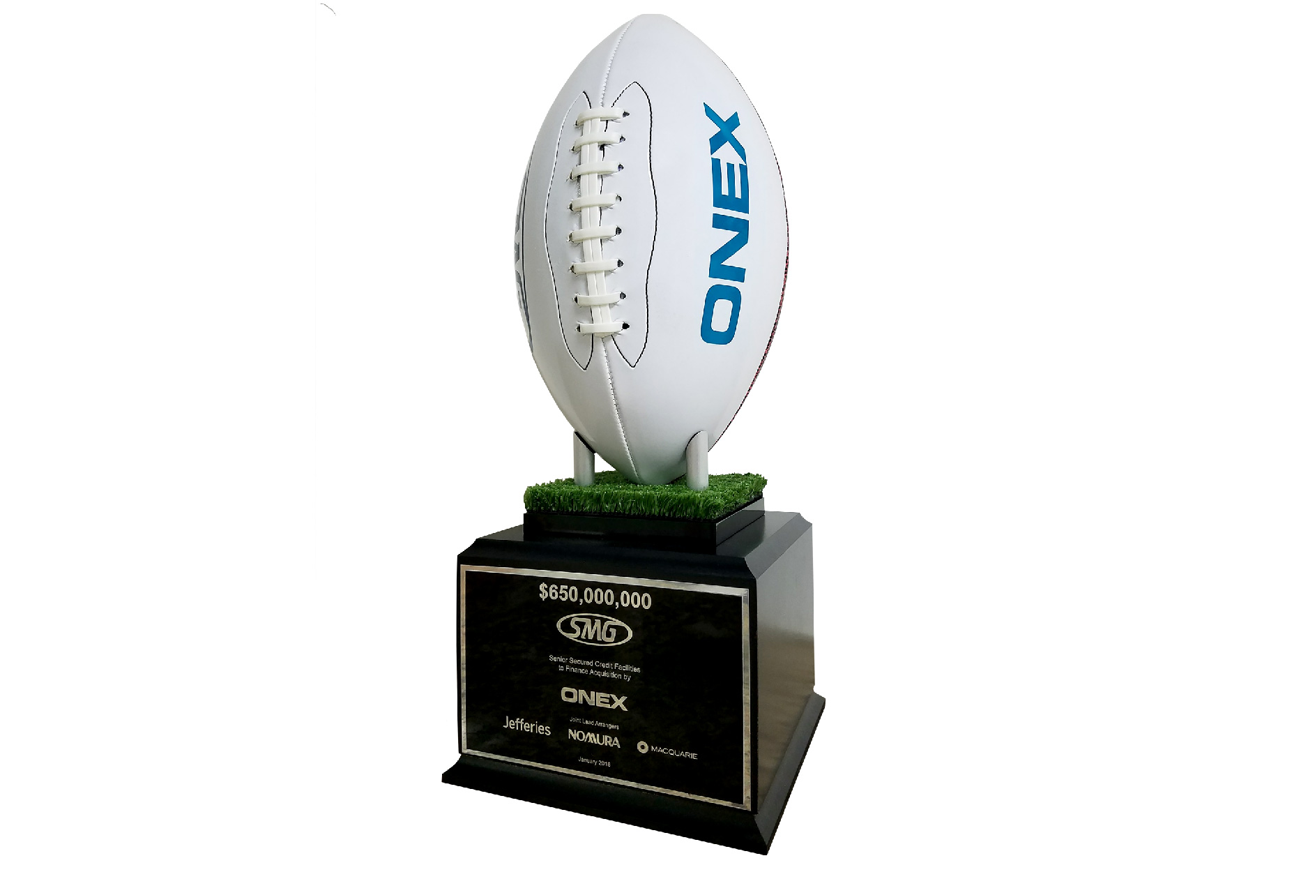 Football personalized with logo and mounted on large base, given for the close of an acquisition deal.