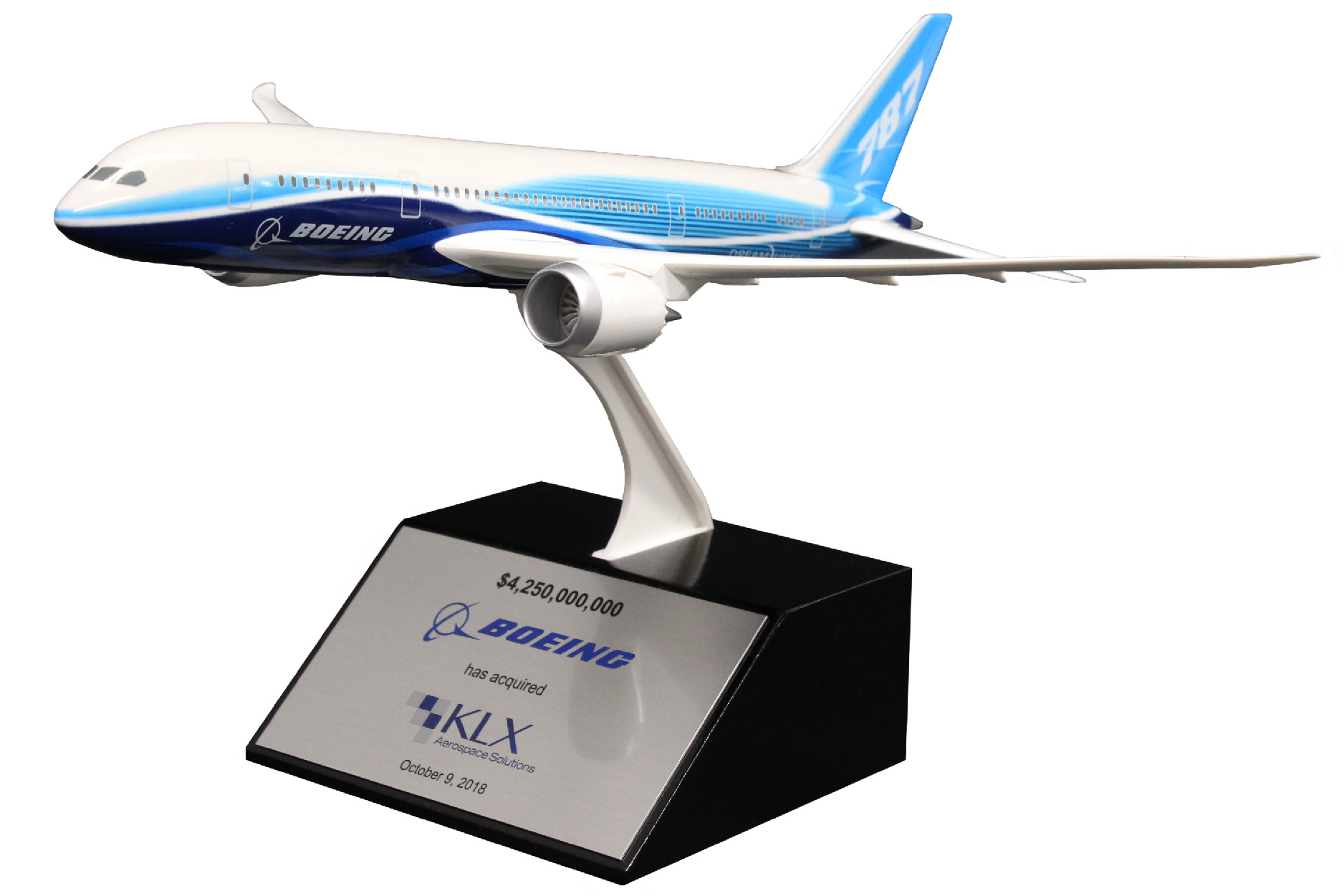 Model plane with custom branding is mounted on a tapered base.