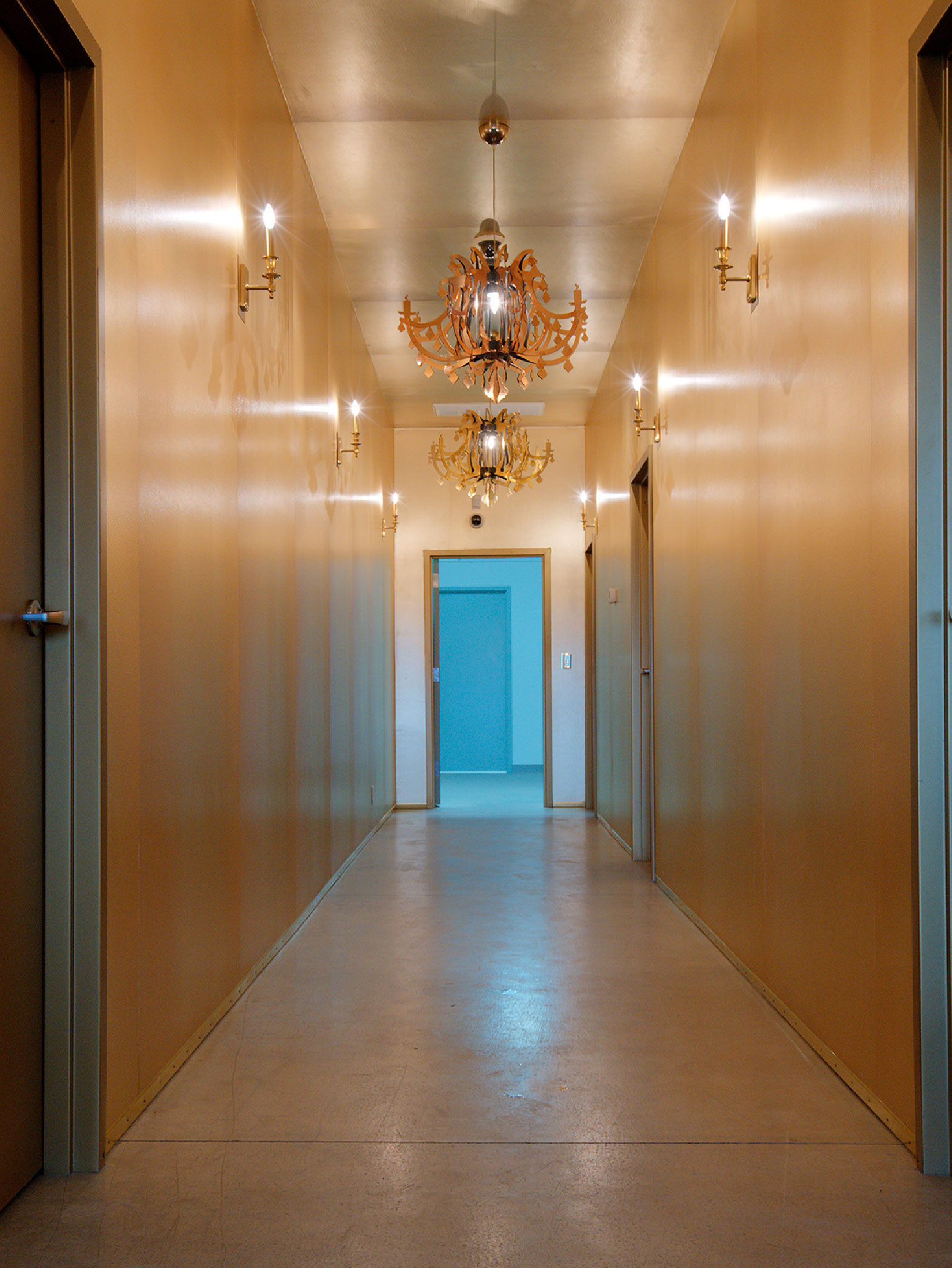 gold wrapped hallway with gold chandeliers