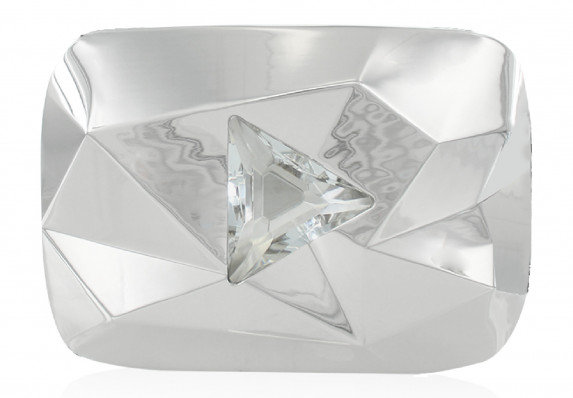 Prestigious Diamond Play Button faceted trophy in brilliantly polished metal with crystal logo detail.
