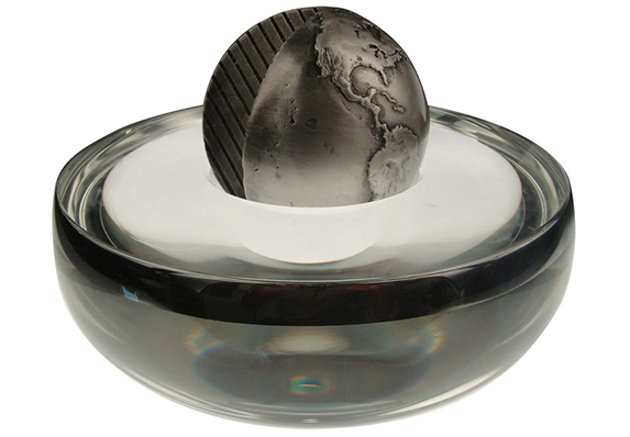 large heavy custom crystal bowl with silver rim and custom cast globe with leaf pattern cut out