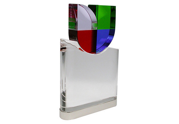 Custom corporate crystal award with brand logo. Presented to employees