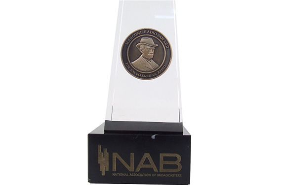 closeup of NAB Marconi medal embedded floating in lucite acrylic