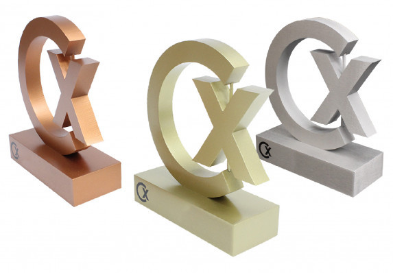 A cut out logo trophy in three brushed metal finishes. This modern recognition award inspires and honors with style.