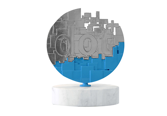 Custom metal web design award with pixel motif. Finished in mirrored chrome with high-end blue enamel detailing and a marble base.