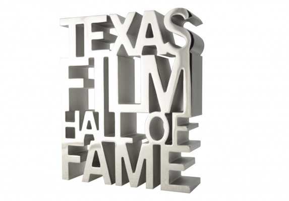 Cut out metal letters create an extruded effect in this high-end aluminum trophy crafted for a film awards program.