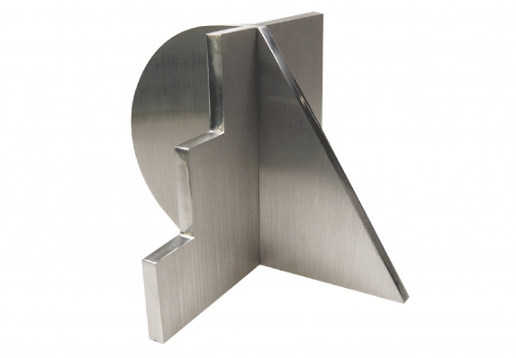 Machined metal trophy with brushed surfaces and polished edges.