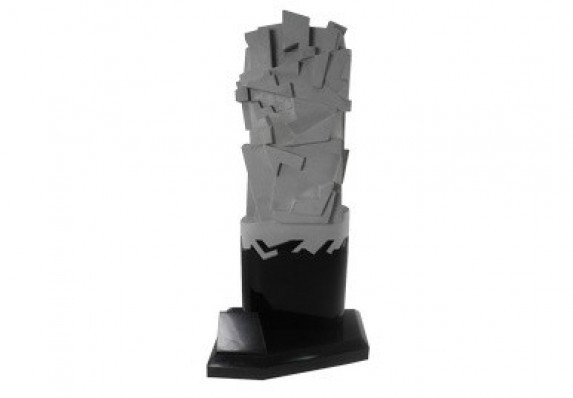 Unique custom trophy with geometric top form in gray that intertwines with sleek black base.