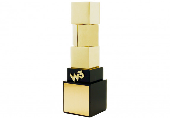 Trophy design with three stacked blocks in highly-polished metal. With wood base and metal logo detail.